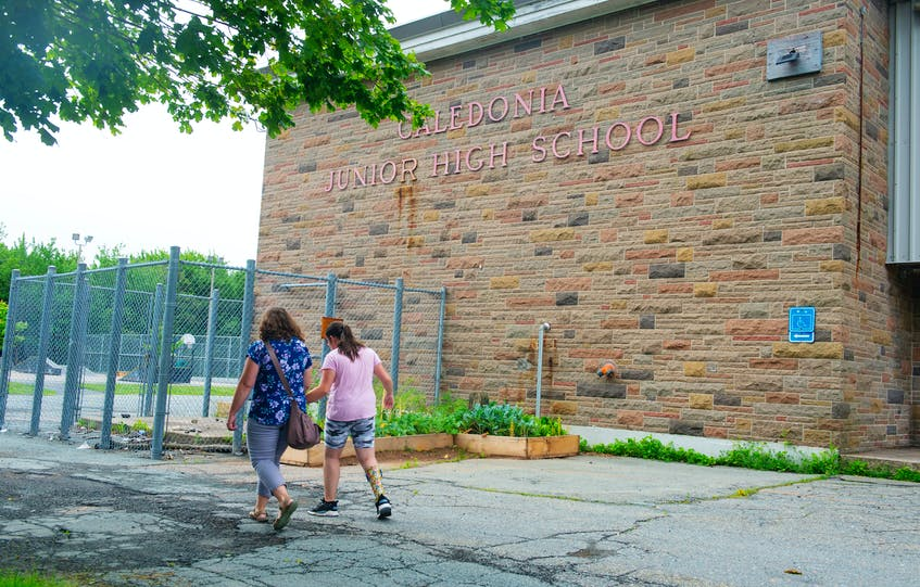 Amanda Lawlor and her daughter Mairin, 12, walk past the front of Caledonia Junior High on Monday, July 19, 2021. Mairin is starting at Caledonia this September and her mom is concerned the lack of accessibility at the school. - Ryan Taplin