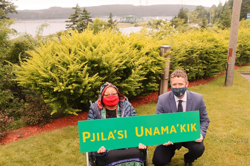 Elder Ma'git Poulette and Premier Iain Rankin pose with a mock-up of the new Mi'kmaw language welcome sign, which was installed on the bridge to Cape Breton last week. Poulette, a survivor of Shubenacadie Indian Residential School, led the effort to have the sign added to welcome motorists to the island. FACEBOOK PHOTO