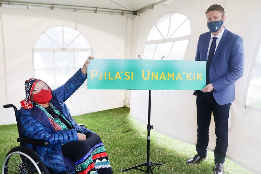 Elder Ma'git Poulette, left, from We'koqma'q First Nation, was emotional when she unveiled the new sign, which reads 'Pjila'si Unama'kik,' with Nova Scotia premier, Iain Rankin on June 11 in Port Hastings. FACEBOOK PHOTO