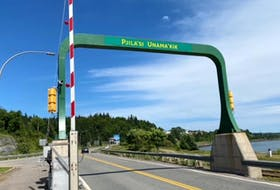 """The new sign welcoming motorists to the island in Mi'kmaw was an idea brought forward by elder Ma'git Poulette of We'koqma'q First Nation, a residential school survivor who lost her language and culture when she was removed from her family and community at the age of three and called the installation of the sign on the causeway, """"A dream come true."""" FACEBOOK PHOTO"""