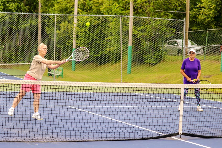 Shirley Hodgson, left, and Jane Fifield are shown in action at the Cromarty Tennis Club in Sydney Friday morning. Despite both being in their 80s, the Sydney residents enjoy going to the courts every morning between 7-9 a.m. to play the sport they love in the summer. JESSICA SMITH/CAPE BRETON POST.