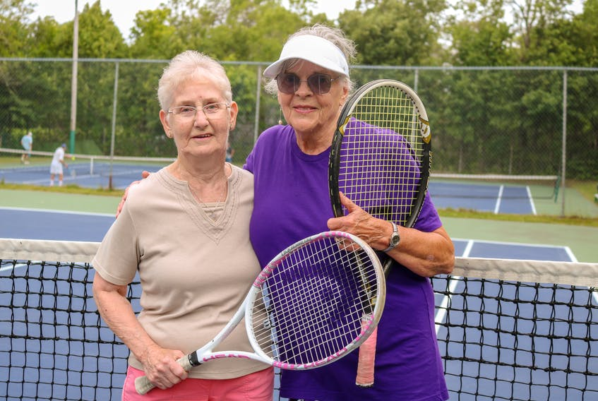 From left, Shirley Hodgson, 86, and Jane Fifield, 81, are the oldest members at Cromarty Tennis Club in Sydney. The Sydney residents say they don't feel their age when they take to the court almost every day during the summer season. JESSICA SMITH/CAPE BRETON POST.
