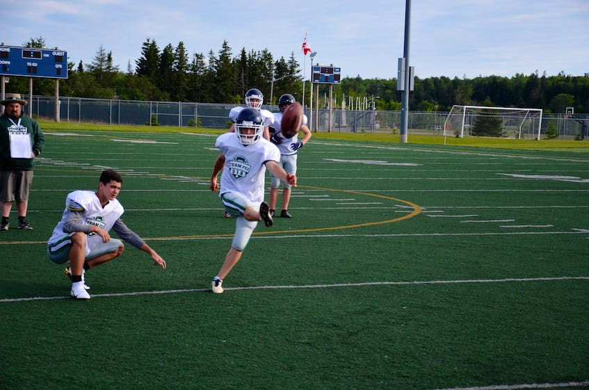 Place-kicker Yannick MacPhee of Charlottetown practises field goals at the Terry Fox Sports Complex in Cornwall on July 14. Zackary Blood is the holder. MacPhee will play his first-ever tackle football game with Team P.E.I.'s under-18 club at the Atlantic Bowl in Antigonish, N.S., on July 21. - Jason Simmonds • The Guardian