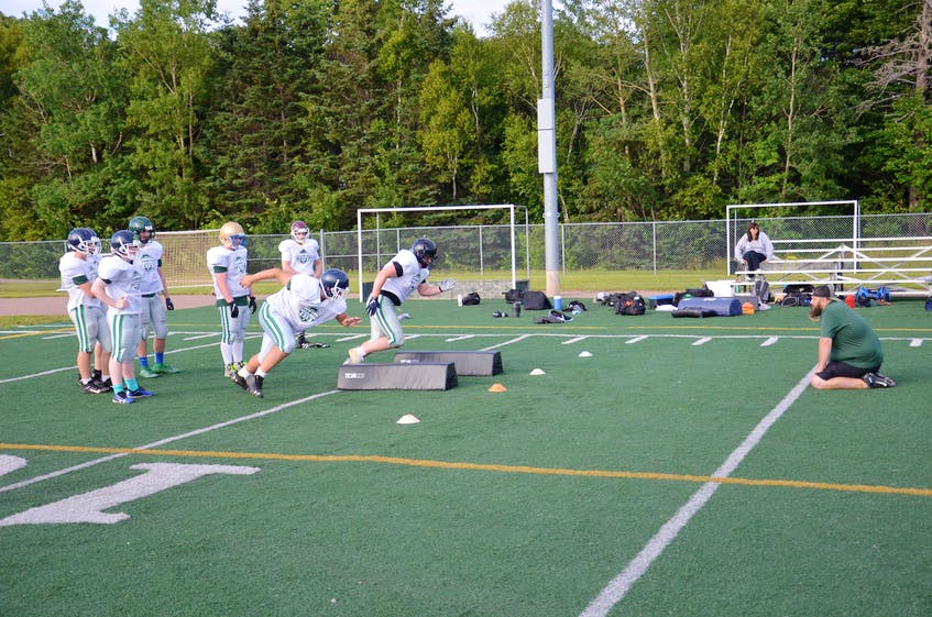 Chris Williams, defensive co-ordinator with Team P.E.I.'s under-18 squad, works with the linemen during a practice at the Terry Fox Sports Complex in Cornwall on July 14. Football P.E.I. is sending under-16 and under-18 teams to the Atlantic Bowl tournament in Antigonish, N.S., July 21-24. - Jason Simmonds • The Guardian
