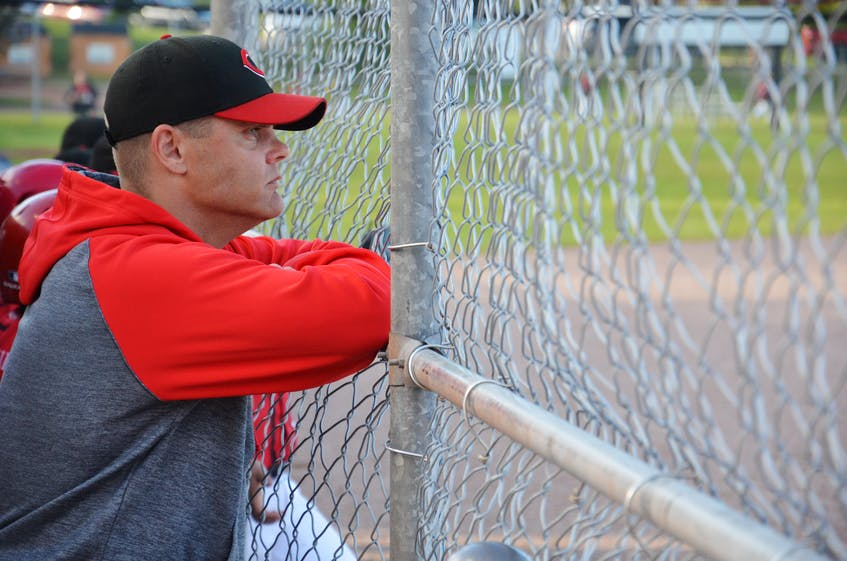 Summerside Chevys' 13-under AAA coach Gordon MacFarlane intently watches the action on the field at Queen Elizabeth Park's Very Important Volunteer Field during a recent game. MacFarlane, who came through the Summerside Area Baseball Association (SABA) program as a player, is now giving back as a coach. The 2021 season marks SABA's 40th anniversary.