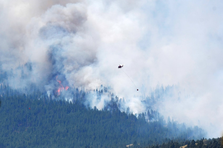 A wildfire burns outside of the town of Lytton, B.C., on Thursday, July 1, 2021. - Jennifer Gauthier / Reuters