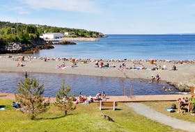 """Less than two weeks after experiencing plummeting temperatures and """"June-uary"""" snowfall, the sun was splitting the rocks at a popular swimming hole in Harbour Main, N.L. Gary Mitchell says: """"this beach is 2 for 1 with freshwater in front and the cool saltwater of Conception Bay on the other side."""""""