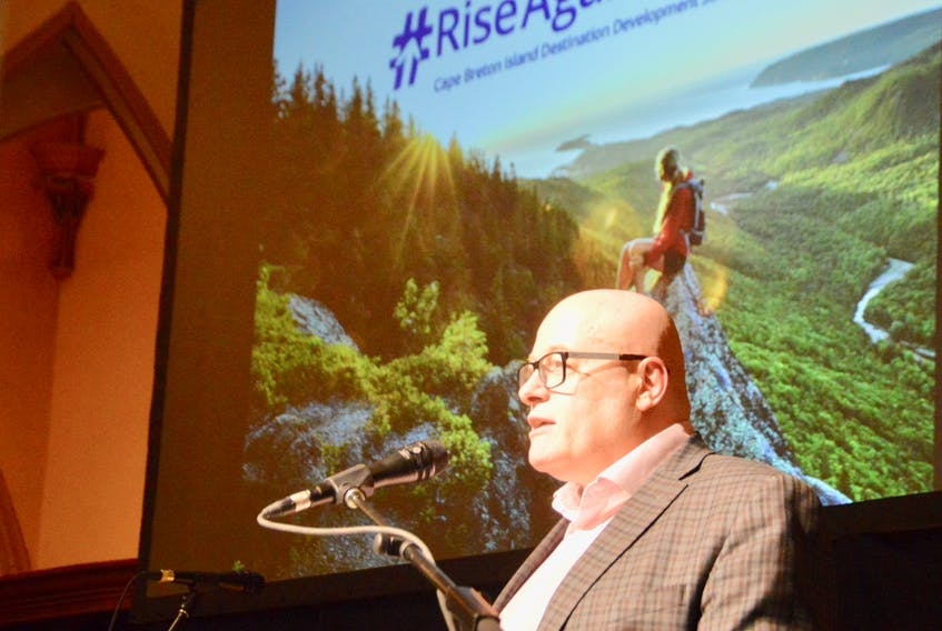 Destination Cape Breton Association chief executive officer Terry Smith unveils the organization's new destination development strategy to a group of tourism operators and industry insiders on Wednesday in Sydney. DAVID JALA/CAPE BRETON POST