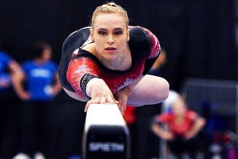 Canadian gymnast Ellie Black on the balance beam at an international competition. - Dan Galbraith/Gymnastics Canada
