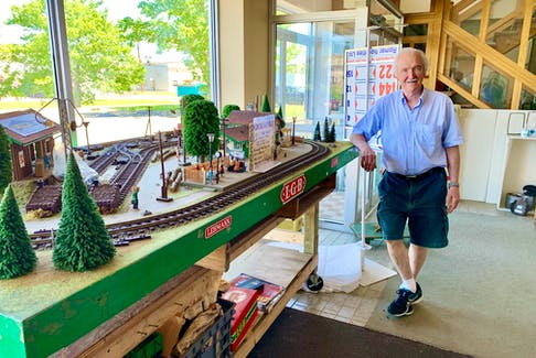 Dave Jackman stands next to a large toy train track, which is displayed in the window at his Romar Enterprises Ltd. store. After 46. years in business, Jackman officially closed on June. 15.