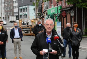 St. John's Mayor Danny Breen speaks to reporters Friday at the reopening of the downtown pedestrian mall. Joe Gibbons • The Telegram