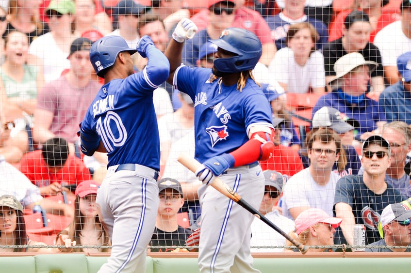 Blue Jays' Marcus Semien  celebrates with teammate Vladimir Guerrero Jr. after hitting a solo home run in the second inning against the Boston Red Sox at Fenway Park on June 13, 2021 in Boston. - Kathryn  Riley