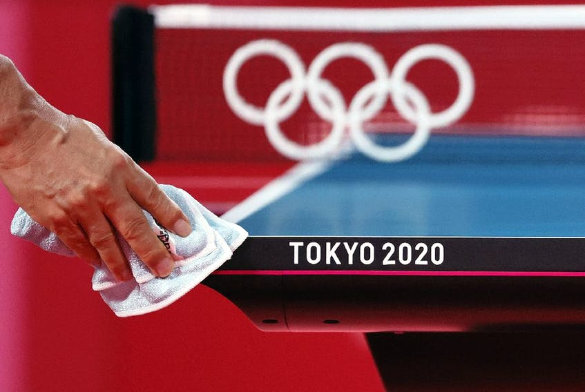 A worker disinfects a table tennis court ahead of the 2020 Tokyo Summer Olympic Games at Tokyo Metropolitan Gymnasium on July 19, 2021 in Tokyo, Japan.