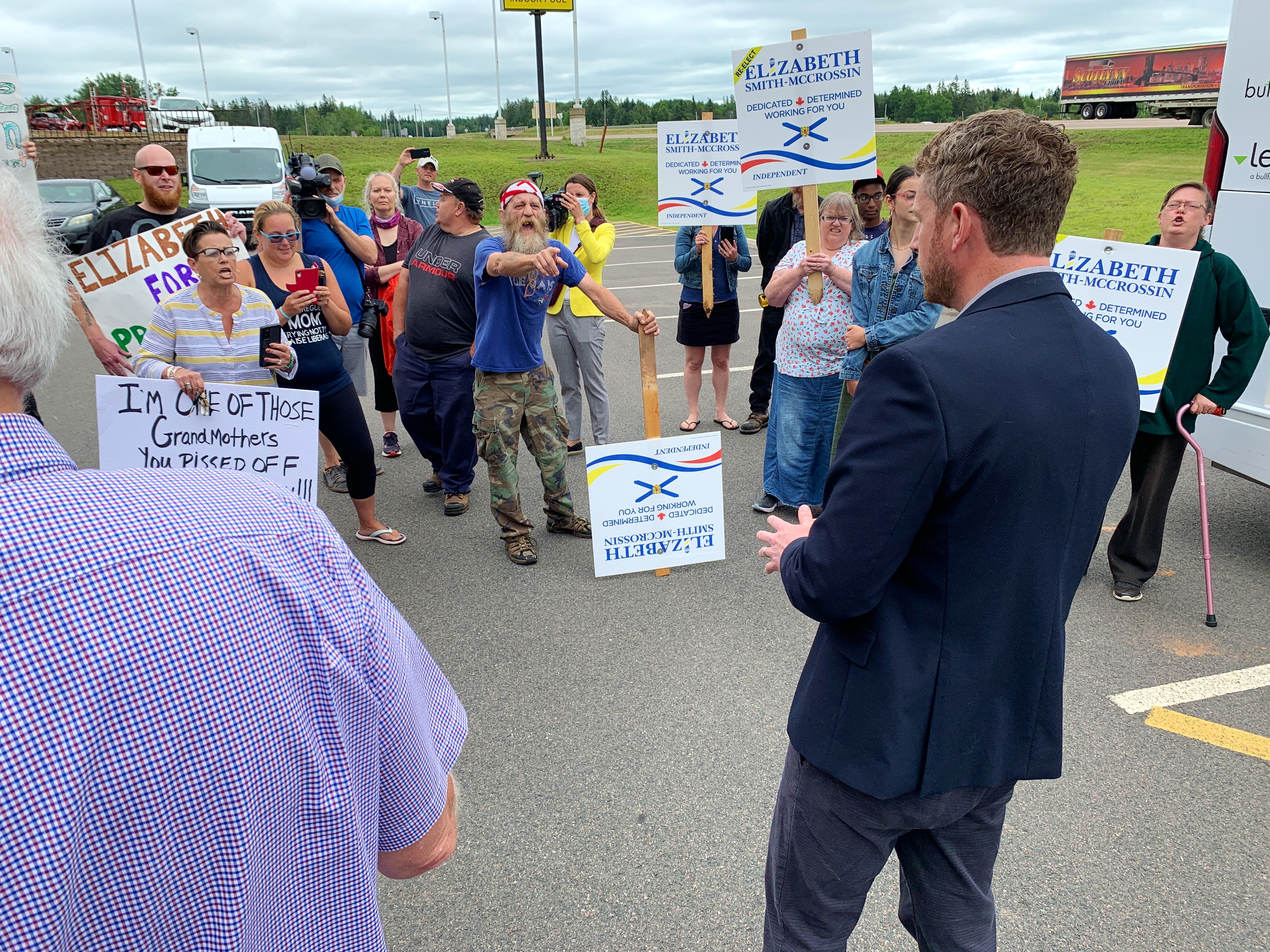 Nova Scotia Premier Iain Rankin is heckled during a visit to Amherst Tuesday during which he announced non-commercial Nova Scotia drivers will no longer have to pay the toll to use the Cobequid Pass after Oct. 1.