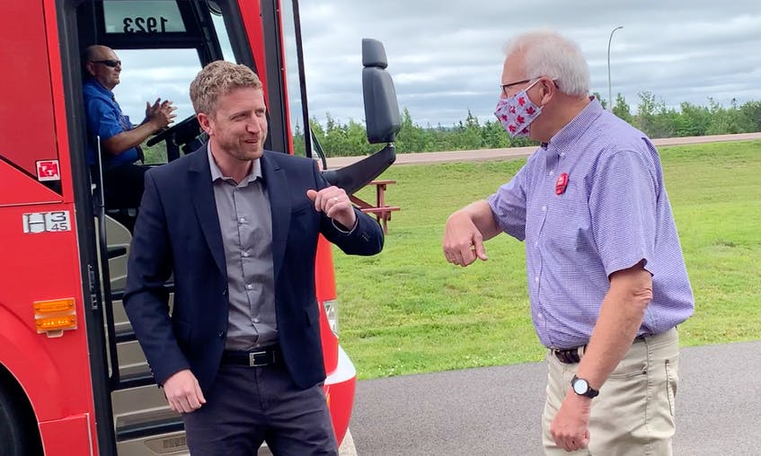 Nova Scotia Liberal Leader Iain Rankin bumps elbows with Cumberland North Liberal candidate and former MP Bill Casey during a campaign stop in Amherst on Tuesday. - Darrell Cole