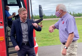 Nova Scotia Premier Iain Rankin prepares to bump elbows with Cumberland North Liberal candidate and former MP Bill Casey during a campaign stop in Amherst on Tuesday. Darrell Cole - SaltWire Network
