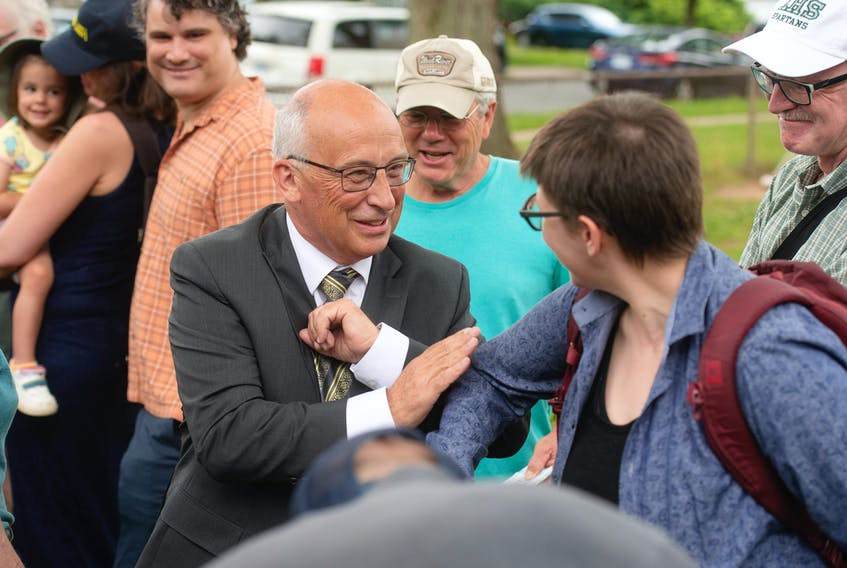 NDP leader Gary Burrill, bumping elbows with supporters following a campaign launch rally in Halifax on Saturday, says it is incumbent on political parties to stand up for anyone facing attacks to ensure more people from a diversity of backgrounds are able to successfully run for office. -- Ryan Taplin - The Chronicle Herald