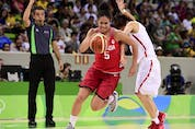 Canada's guard Kia Nurse (L) runs past China's guard Zhao Zhifang during a Women's round Group A basketball match between China and Canada at the Youth Arena in Rio de Janeiro on August 6, 2016 during the Rio 2016 Olympic Games.