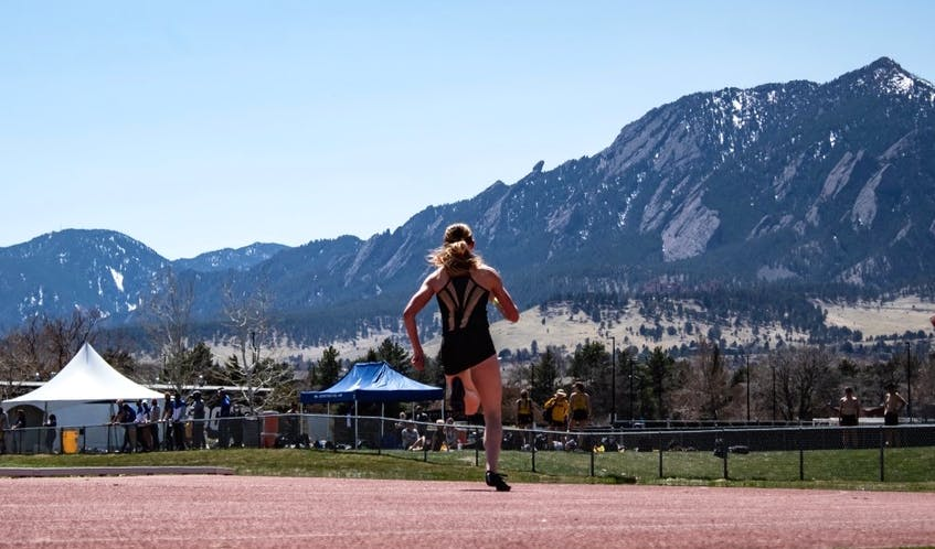 Lauren Gale is shown competing at a competition as the mountains of Rocky Mountain National Park are pictured in the foreground. The 21-year-old will represent Canada in track and field at the Tokyo Olympics next month. PHOTO CONTRIBUTED/COLORADO STATE UNIVERSITY.