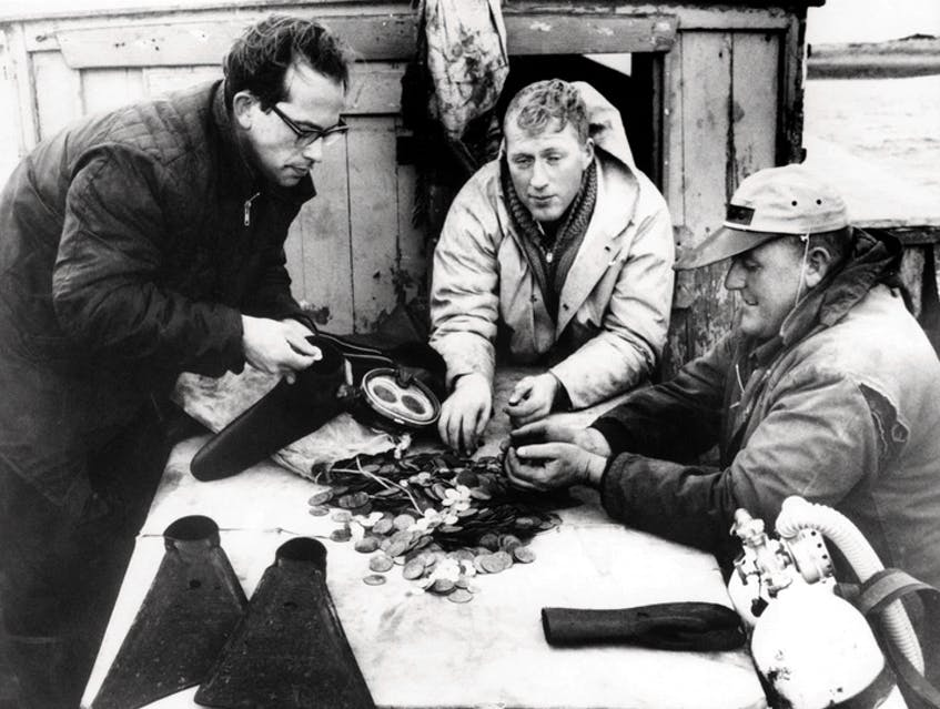 From left, Alex Storm, Harvey MacLeod and David MacEachern are shown with some of the coins they salvaged from the sunken wreck of the Chameau, an 18th-century French ship, in 1965. CONTRIBUTED/ARGOSY PHOTO VIA UNITED PRESS INTERNATIONAL