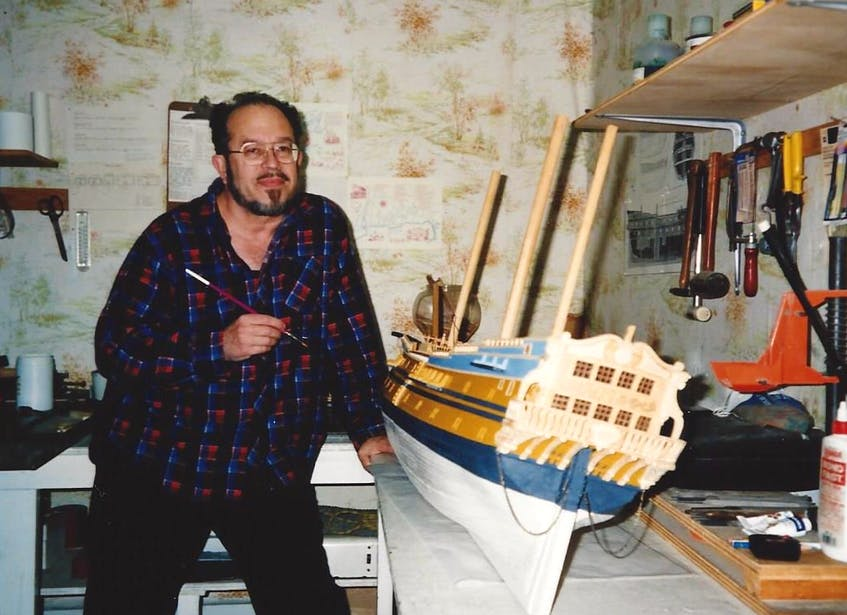Shipwreck hunter Alex Storm is shown putting the finishing touches onto a model of Le Chameau, the treasure ship discovered off the coast of Louisbourg in 1965.