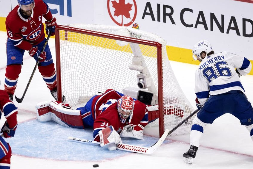 Canadiens goaltender Carey Price manages to stop Lightning's Nikita Kucherov as Canadiens defenceman Shea Weber looks on during Game 3 of the Stanley Cup final earlier this month at the Bell Centre.