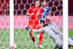 Christine Sinclair (No. 12) of Canada scores during the Women's First Round Group E match between Japan and Canada during the Tokyo 2020 Olympic Games at Sapporo Dome on July 21, 2021 in Sapporo, Hokkaido, Japan.