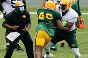 Defensive end Shawn Lemon (40) rushes offensive tackle Thaddeus Coleman (50) during Edmonton Elks training camp at Commonwealth Stadium in Edmonton on Tuesday, July 20, 2021. The team faces the Ottawa Redblacks in their first CFL game of the season at home on Aug. 7.