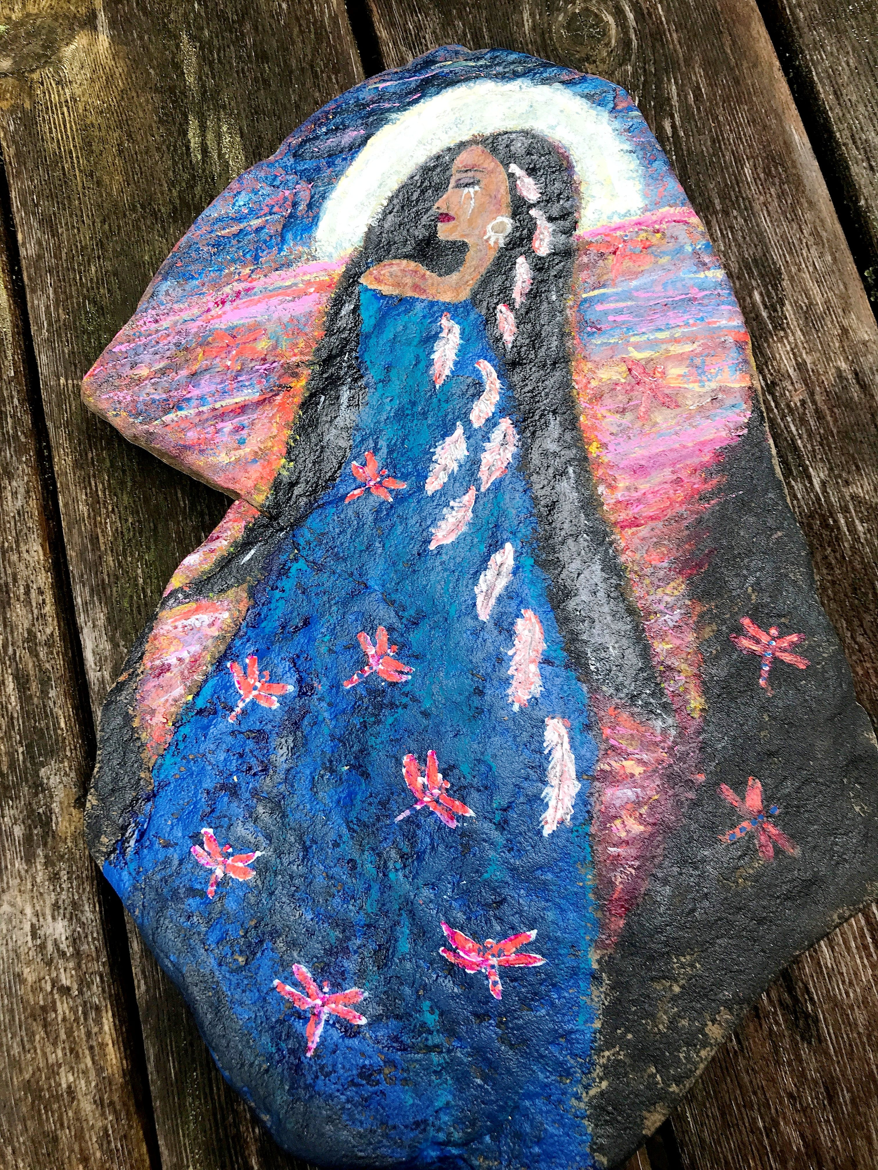 Isn't this rock magnificent?  Kim Dickinson painted this rock with acrylic in honour of the Indigenous children who never returned home. It goes with a stirring poem she wrote, Whispers & Wings.