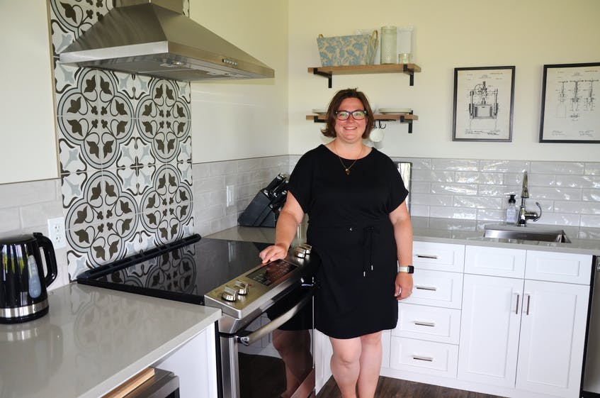 Owner Melanie Eelman in the Beausoleil Farmstead's farm stay accommodation, which features its own kitchen and many more amenities. - Kirk Starratt