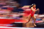 Simone Biles warms up on the vault prior to the Women's competition of the 2021 U.S. Gymnastics Olympic Trials.
