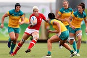 Jennifer Kish of Canada gets tackled during the Women's Semi Final 1 Rugby Sevens match between Australia and Canada on Day 3 of the Rio 2016 Olympic Games at the Deodoro Stadium on August 8, 2016 in Rio de Janeiro, Brazil.