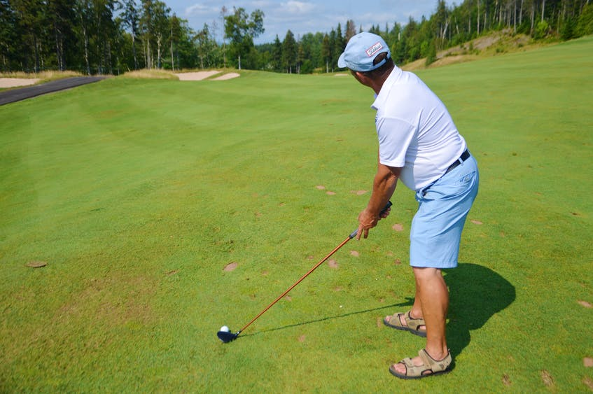 Martin Burke of Sydney looks towards the No. 18 hole pin at The Lakes Golf Club in Ben Eoin. The 64-year-old hit an albatross – otherwise known as a double eagle – from the exact spot last month. JEREMY FRASER/CAPE BRETON POST