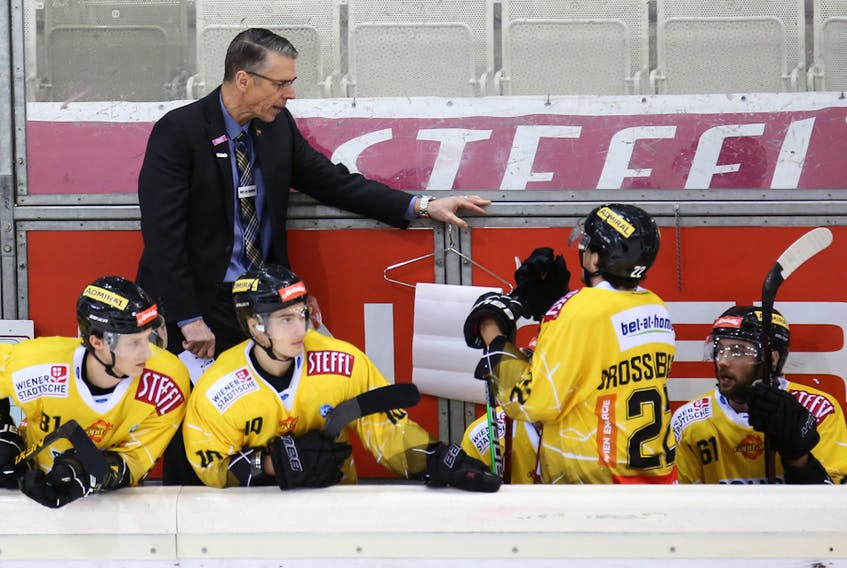 Vienna Capitals head coach Dave Cameron talks to his players during a game in the International Central European (ICE) Hockey League. Martina Bednar Photo