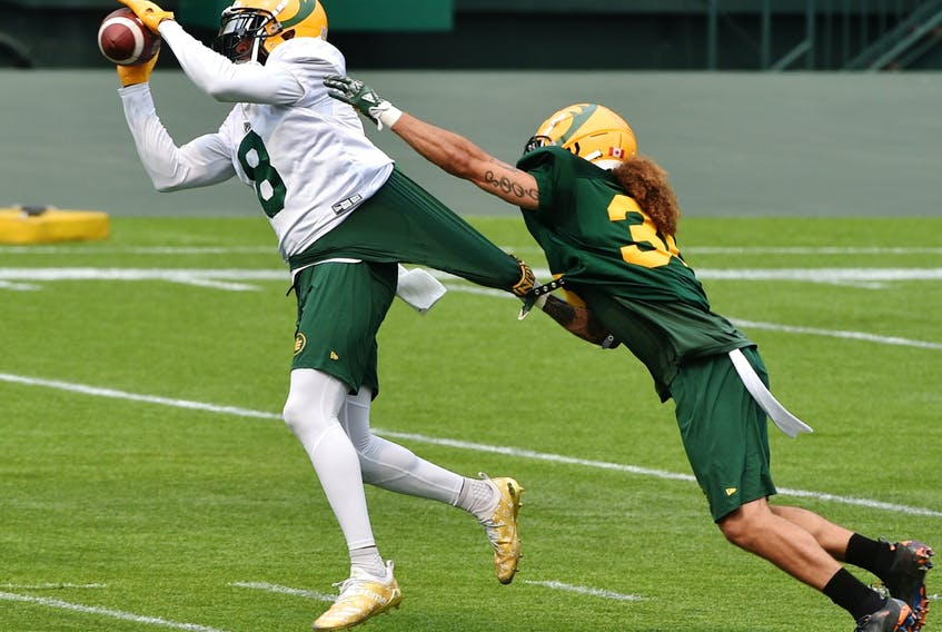 Wide receiver Kenny Stafford (8) makes the catch on defensive halfback Aaron Grymes (36) during Edmonton Elks training camp at Commonwealth Stadium in Edmonton on July 16, 2021.