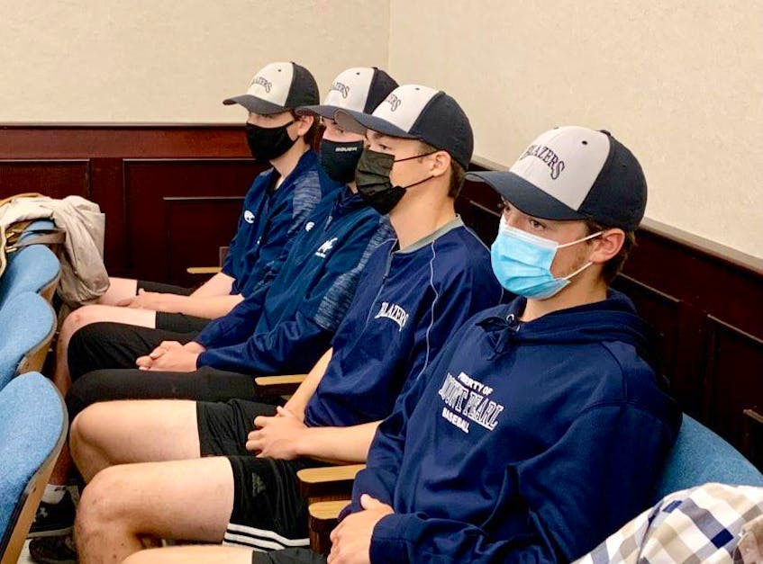 Members of the Mount Pearl Blazers under-18 baseball team — (from left) Cameron Pennell, Ryan Murphy, Liam Bavis and Jacob Skiffington — were at Mount Pearl City Hall Wednesday to hear the announcement that the city will build a new civic centre, which will include an outdoor splash pad and outdoor ice surface. Rosie Mullaley/The Telegram