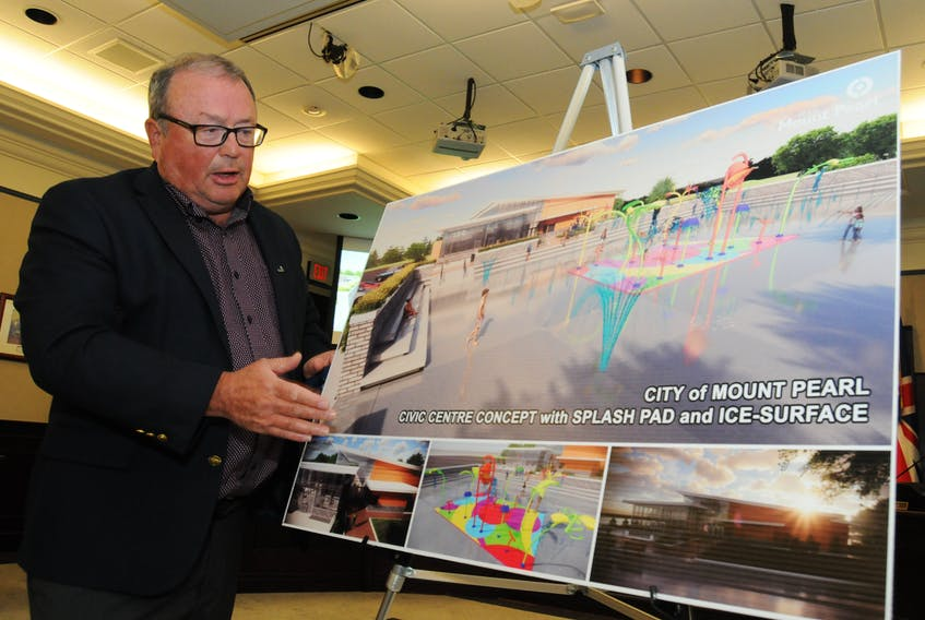 Mount Pearl Mayor Dave Aker, standing beside an artist's conception of the proposed new civic centre, speaks Wednesday about the planned 18,000-square-foot facility. Joe Gibbons • The Telegram