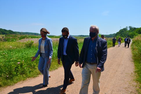 Kentville Mayor Sandra Snow, Kings-Hants MP Kody Blois and Kings South MLA and Environment and Climate Change Minister Keith Irving take a stroll down the Harvest Moon Trail following their respective funding announcements for active transportation lanes, pathways and crossings in Kentville. KIRK STARRATT