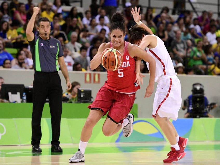 Canada's guard Kia Nurse (L) runs past China's guard Zhao Zhifang during a Women's round Group A basketball match between China and Canada at the Youth Arena in Rio de Janeiro Aug. 6, 2016 during the Rio 2016 Olympic Games. - Postmedia  photo