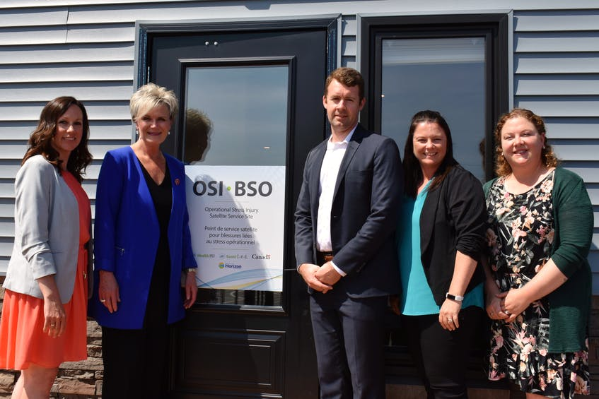 The team at the Occupational Stress Injury Satellite Service stands outside the door of the newly opened site in Stratford. From left are Lorna Hutt, director of community mental health and addiction with Health P.E.I., Cathy Chadwick, manager, Jevan Walker, clinical social worker, Carrie MacDonald, administrative assistant, and Jillian Gallant, mental health registered nurse. - Michael Robar