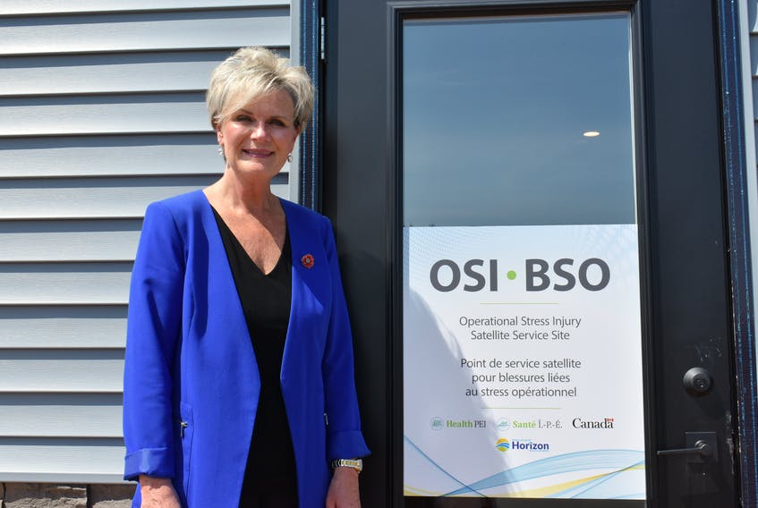Cathy Chadwick, manager of the Occupational Stress Injury Satellite Service, stands outside the door of the new site in Stratford on July 13.