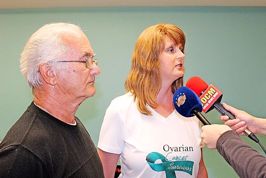 Jeff Blackwood and Susan Glynn speak with media about a petition calling for designated parking for patients receiving cancer treatment at the Dr. H. Bliss Murphy Cancer Centre in this 2016 file photo.