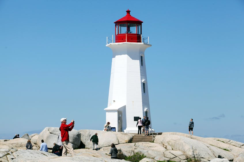 Tourists visit Peggys Cove in this file photo from July 2019. - Eric Wynne