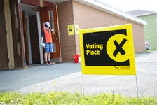 FOR ELECTION STORY: Ryley Boutilier, an information officer waits for some early voters at a returning office in the basement of Anglican Church of the Holy Spirit, in Dartmouth Wednesday July 21, 2021.  TIM KROCHAK PHOTO