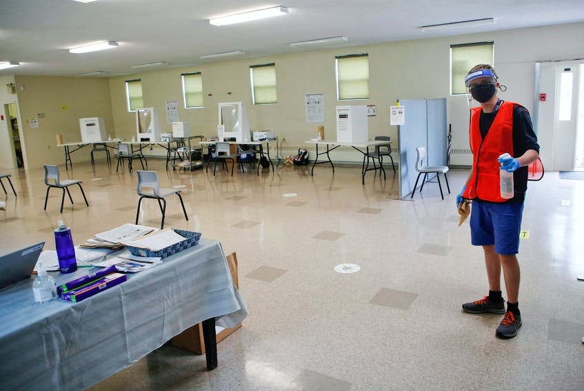 Ryley Boutilier works in the voting area at a returning office in the basement of the Anglican Church of the Holy Spirit in Dartmouth. - Tim Krochak