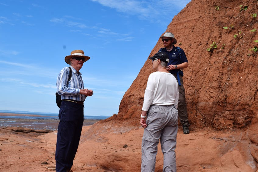 Geoscientist Caleb Grant talks with Steve Johnson and Rosemary Rowntree on the tour.