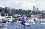 A decorated boat cruises Lake Union at the Seattle Kraken 2021 NHL expansion draft at Gas Works Park on July 21, 2021 in Seattle, Washington.