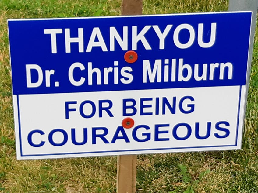 Professionally made lawn signs have begun appearing in Cape Breton in support of fired outspoken ER physician Dr. Chris Milburn. A picture of one of the signs was posted on Facebook and went viral. - Contributed