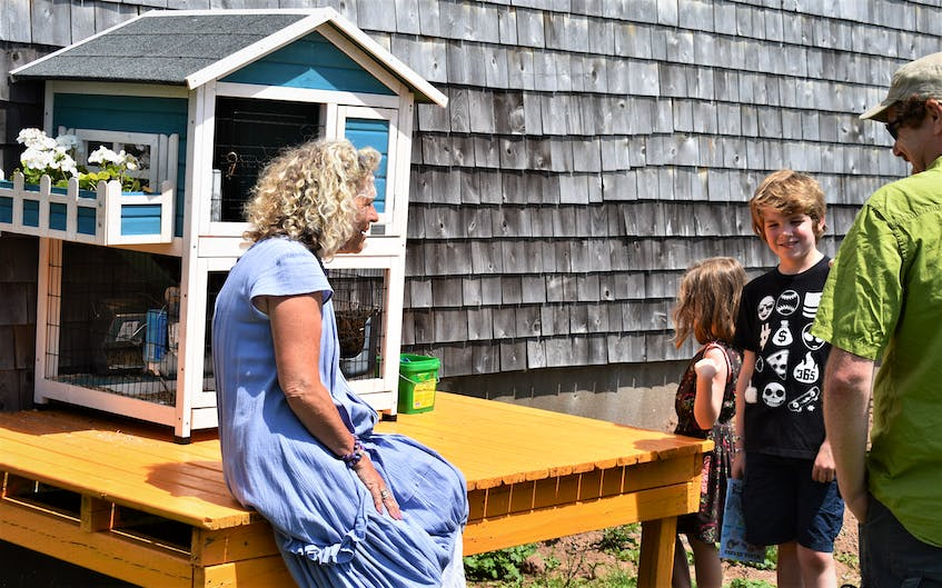 Author and shoppe owner Sheree Fitch chats with a family from Fredericton, N.B. during a special day at Mabel Murple's Book Shoppe and Dreamery in River John, July 18, celebrating Gaspereau Press. - Richard MacKenzie