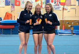 Island gymnasts enjoyed some outstanding placings at the recent Canadian championships, which were held virtually due to COVID-19 restrictions cancelling the in-person event. Pictured with their ribbons are three members of the Island Gymnastics Academy (IGA). From left are Ella MacDougall, Victoria Covey and Sophie Mayne.